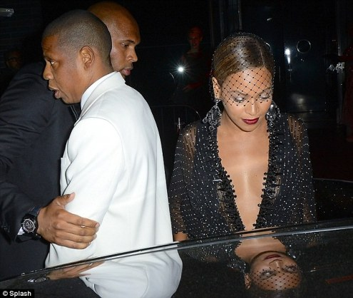 No Sir, This Way Please: For his own safety, Jay Z is led away from the car of his raging sister-in-law